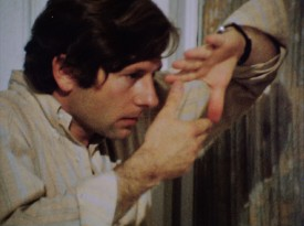 "A young Roman Polanski frames a shot with his hands in behind-the-scenes footage from ""Remembering 'Rosemary's Baby."""