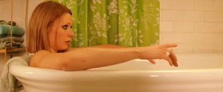 Lately, depressive sister Margot (Gwyneth Paltrow) has been taking refuge watching television in a bathtub.
