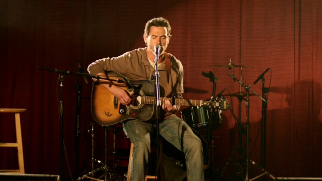"In ""Rudderless"", Sam Manning (Billy Crudup), a father mourning the death of his son, finds solace in playing his son's music."