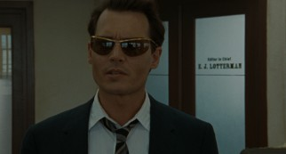 Paul Kemp (Johnny Depp) reports to the San Juan Star in sunglasses, allegedly to protect his conjunctivitis.