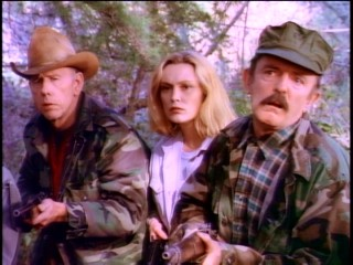 Two minute men (Rance Howard and John Astin) take the girls for Soviet spies, while the latter's wife (Cathy Moriarty) is less convinced.