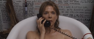 Deirdre Burroughs (Annette Bening) takes a phone call in the bathtub surrounded by a sea of hand-written words.
