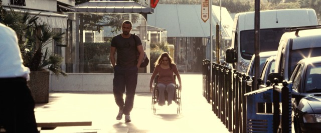 "Friends with benefits Ali (Matthias Schoenaerts) and Stéphanie (Marion Cotillard) share a walk and roll in ""Rust and Bone."""