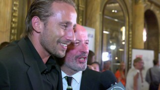 Belgian man Matthias Schoenaerts and director/co-writer Jacques Audiard share a jolly moment on the red carpet of the 2012 Toronto International Film Festival.