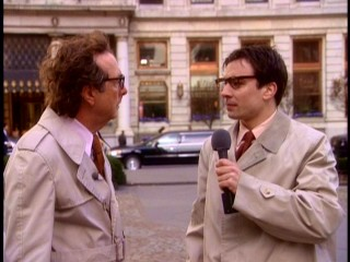 "In ""Can't Buy Me Lunch"", Melvin's reports are repeatedly introduced by a younger journalist (Jimmy Fallon) who's discovered to be his illegitimate son."