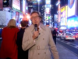 "Melvin Hall (Eric Idle) reports from Times Square and other locations around the globe in ""Can't Buy Me Lunch."""