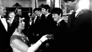 "The Queen of England (Jeannette Charles) meets the Rutles in a cramped scene from ""The Rutles in All You Need Is Cash."""