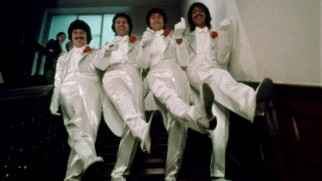 The Rutles descend a staircase in style.
