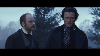Doctor Clements (Adrian Rawlins) informs Detective Fields (Luke Evans) on his friend's death and the date in this deleted scene.