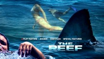 Swimmers swim past a shark fin and the distressed cover man on the DVD's main menu.