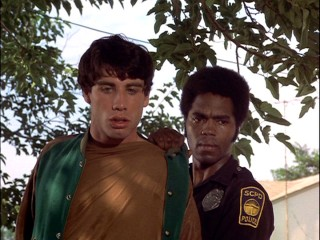 "Terry arrests a 19-year-old John Travolta in ""Frozen Smoke."""