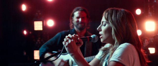 "Ally (Lady Gaga) experiences a rise to stardom under the tutelage of Jackson Maine (Bradley Cooper) in 2018's (#7) ""A Star Is Born."""