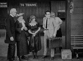 "Next stop: Los Angeles. Harold Lloyd awaits the train to take him to the big city in ""Safety Last!"""