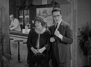 With Mildred (Mildred Davis) making a surprise visit to his workplace, Harold (Harold Lloyd) scrambles to look as important as he's claimed.