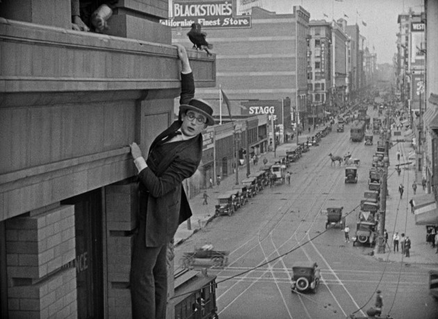 "The once thrilling, long iconic climax of ""Safety Last!"" finds Harold Lloyd bravely dangling from a Los Angeles skyscraper above crowds of onlookers."