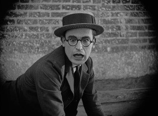 "Harold Lloyd is surprised and none too pleased to spot a cop he recognizes in ""Safety Last!"""