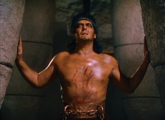 His mane restored but not his eyesight, Samson (Victor Mature) topples the temple of Dagon by brute force in the film's climactic scene.