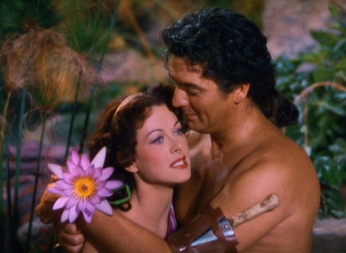 "Samson (Victor Mature), Delilah (Hedy Lamarr) and a flower share a Technicolor embrace in Cecil B. DeMille's 1949 Biblical epic ""Samson and Delilah."""