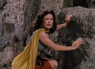 Delilah (Hedy Lamarr) watches excitedly as Samson wrestles a lion with his bare hands.