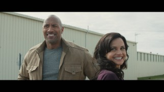 Dwayne Johnson and Carla Gugino share a laugh in the gag reel.
