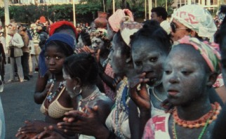 "Girls of West Africa appear with chalk on their faces for some reason in ""Sans Soleil."""