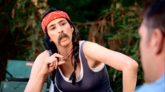 Sarah (Sarah Silverman) embraces her inner man with a mustache on her face and a lost part of herself around her neck.