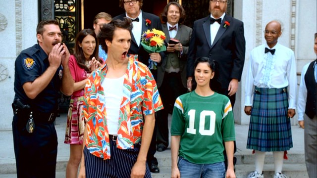 An Ace Ventura impersonator (Matthew Patrick Davis) joins Sarah and friends as they gather on the steps of Valley Village's town hall for Steve and Brian's gay wedding.