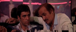 Miami cocaine kingpin Frank Lopez (Robert Loggia) takes Tony (Al Pacino) under his wing, quite literally here.
