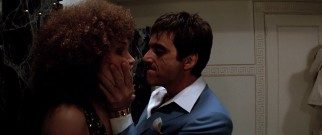 Tony (Al Pacino) is overprotective of his younger sister Gina's (Mary Elizabeth Mastrantonio) sexuality, but tolerates her afro.