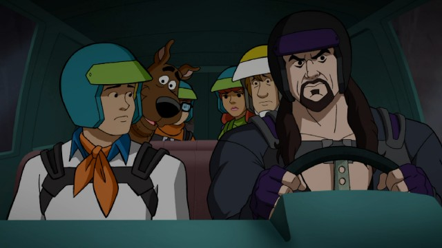 "The Scooby-Doo gang rides with The Undertaker in ""Scooby-Doo! and WWE: Curse of the Speed Demon."""