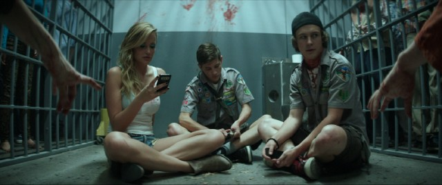 Denise (Sarah Dumont), Ben (Tye Sheridan), and Carter (Logan Miller) find themselves surrounded by zombies after locking themselves into a jail cell.