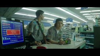 Ben (Tye Sheridan) and Carter (Logan Miller) wait to be helped at the counter of an oddly dead pharmacy in this deleted scene.