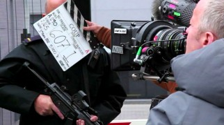 """Secret State"" apparently carried a working title of ""Coup"" as the slate in this behind-the-scenes short shows."