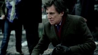 Deputy Prime Minister Tom Dawkins (Gabriel Byrne) visits the site of an oil refinery explosion in Scarrow.