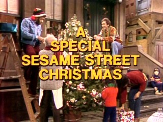 "The human cast of ""A Special Sesame Street Christmas"" decorates the neighborhood tree behind the title logo."