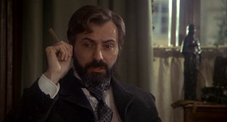Sigmund Freud (Alan Arkin) listens attentively as Sherlock Holmes uses his powers of deduction on him.