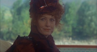 "Vanessa Redgrave plays ""Lady of the Lilies"" Lola Deveraux, the redheaded woman whose abduction drives the film's climactic mystery."