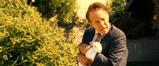 Tom Waits wields a rabbit as Zachariah Rigby, the first and only person to respond to Billy's classified ad looking for inspirational psychopaths.