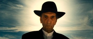 Harry Dean Stanton is silent and ominous as Man in Hat, the Quaker Psychopath invented for Martin's screenplay.