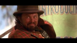 This deleted scene features Curtis Armstrong as circus showman Bulldog Drummond, a character mentioned only by sign in the final film.