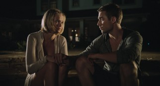 Sara Paxton and Dustin Milligan earn their top billing with romantic looks and tender hand-holding on the shore.