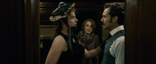 Disguised as a woman, Sherlock Holmes (Robert Downey Jr.) interrupts the honeymoon train ride of Dr. Watson (Jude Law) and Mary (Kelly Reilly).
