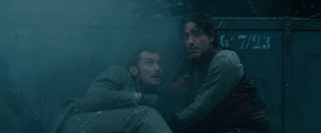 Dr. Watson (Jude Law) and Sherlock Holmes (Robert Downey Jr.) narrowly escape yet another close call.