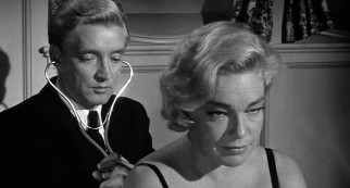 "Dr. Willie Schumann (Oskar Werner) examines an insomniac Spanish countess (Simone Signoret) in ""Ship of Fools."""