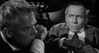 "Bill Tenny (Lee Marvin) declares Karl Glocken (Michael Dunn) a ""sawed-off intellectual"" after the dwarf puts the alcoholic's curveball difficulties in perspective."
