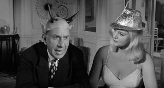 Now, that's subtle: the anti-Semitic Herr Rieber (Jose Ferrer) wears Devil's horns at a ship party he attends with his foolish mistress (Christiane Schmidtmer).