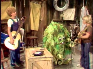 Sigmund discovers a popular singing voice, as the Stuart brothers play guitar on his radio contest-winning song performance.