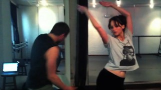 Bradley Cooper and Jennifer Lawrence hone their dancing skills in a brief montage of low-quality rehearsal footage.