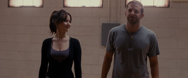 "Tiffany Maxwell (Jennifer Lawrence) and Pat Solitano Jr. (Bradley Cooper) share a smile while rehearsing their dance routine in #5, ""Silver Linings Playbook."""