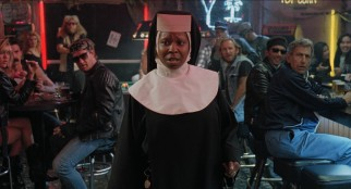 Sister Mary Clarence (Whoopi Goldberg) draws stares from the tough patrons of a bar.